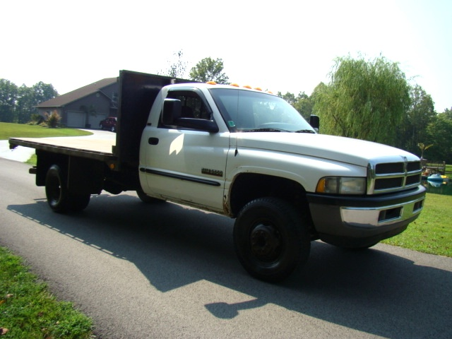 used rv parts 2001 dodge 3500 diesel flat bed 4x4 truck for sale preowned and repairable autos. Black Bedroom Furniture Sets. Home Design Ideas